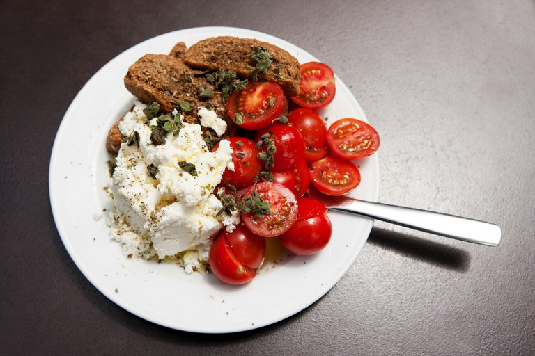 Traditional Cretan salad with feta, rusks and tomatoes