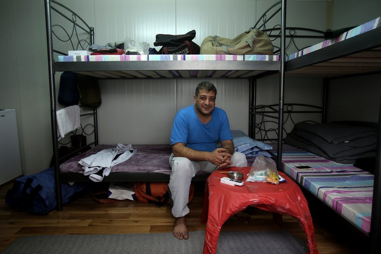 A man inside his container at a refugee camp in Ritsona about 80 kilometers north of Athens.