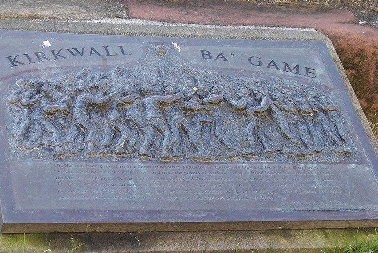 Ba' Game plaque, St. Magnus Cathedral, Kirkwall, Scotland
