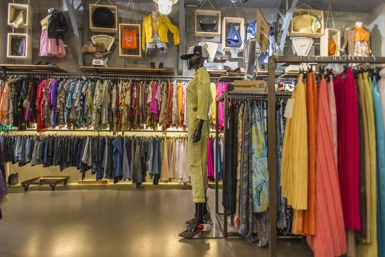 A colorful selection of clothes at Kilo Shop on Boulevard Saint-Germain │ Courtesy of Kilo Shop