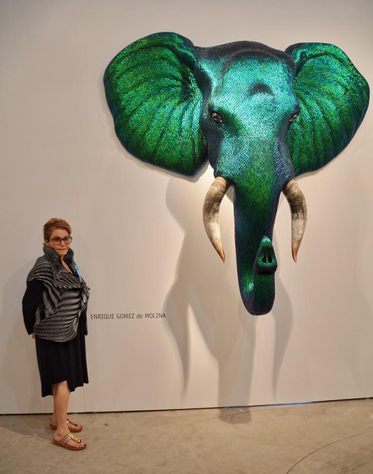 Miami gallerist, Bernice Steinbaum stands beside new work by Enrique Gomez de Molina. Photo Credit | Lisa Morales