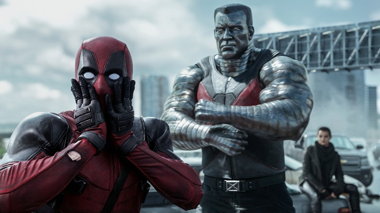 Deadpool (Ryan Reynolds) reacts to Colossus (voiced by Stefan Kapicic)
