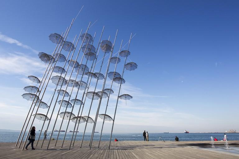 People are enjoying the sunny weather near seaside in Thessaloniki