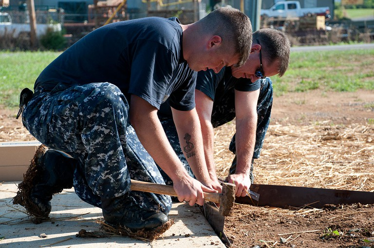 US Navy 100807-N-6466B-079 Sailors install landscaping border at the site of a new Habitat for Humanity home | Public Domain/WikiCommons