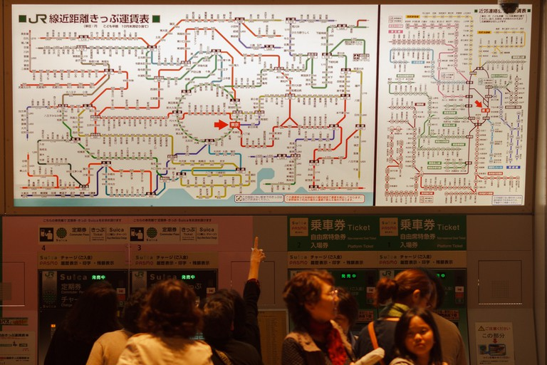 Gesturing at a map of the Tokyo metro, and hoping for the best