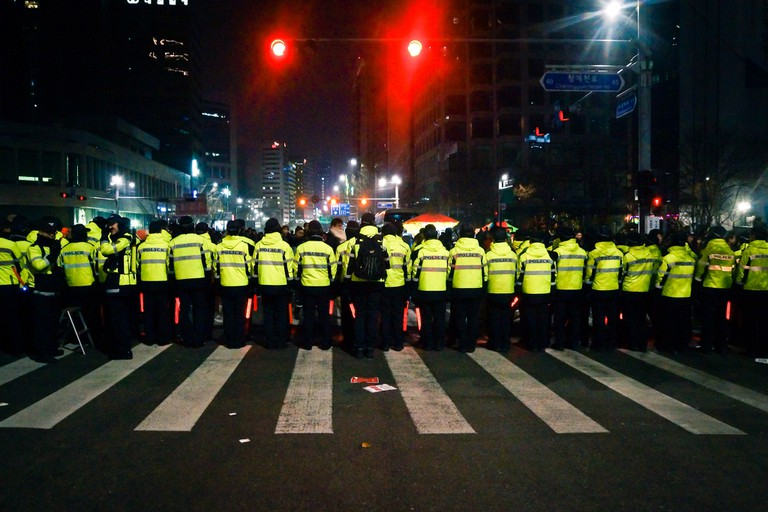Policemen stand guard during New Year's Eve celebrations