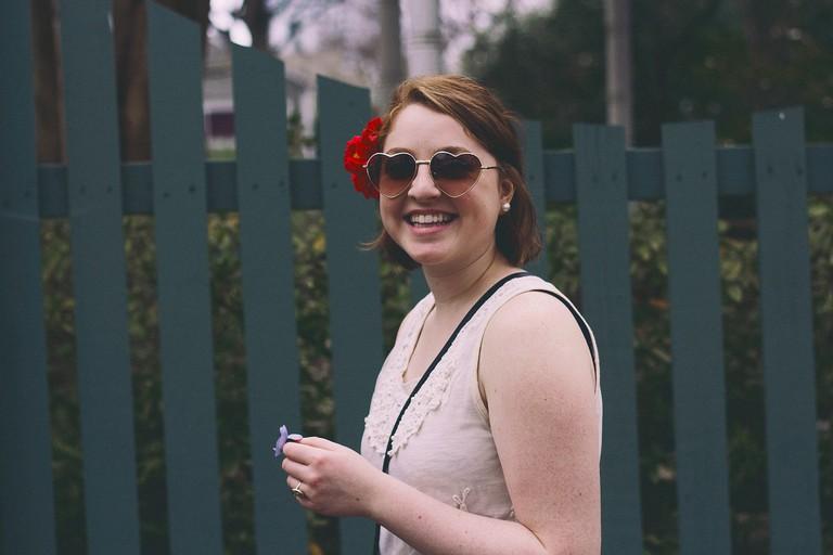 Happy girl with sunglasses | James Garcia / Unsplash