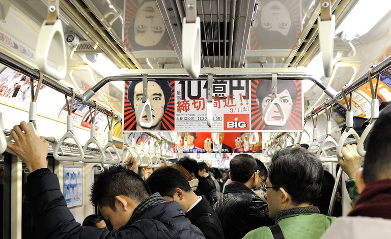 Crowded train in Tokyo | © Tim Adams / Flickr