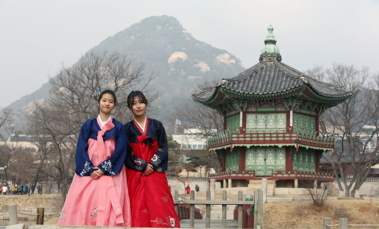 Hanbok-clad girls pose at Gyeongbok Palace