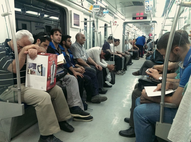 Commuters take a nap on the metro | © Kamyar Adl / Flickr
