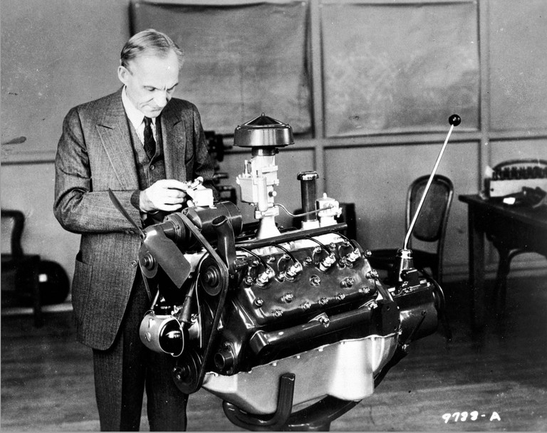 Henry Ford Looking at a V-8 engine