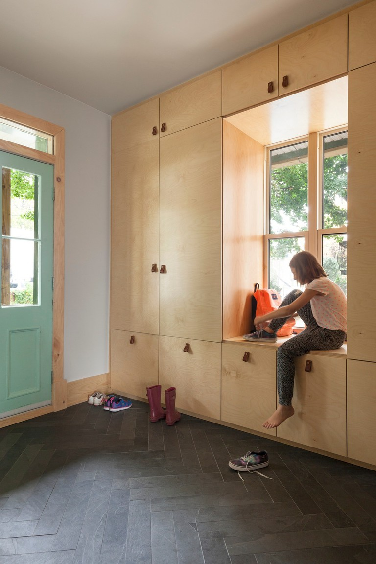 Clever storage hides clutter by the entrance