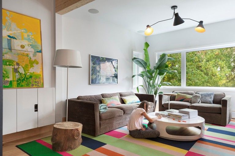 The living area is bright and more colourful than the rest of the house, mimicking the greenery outside