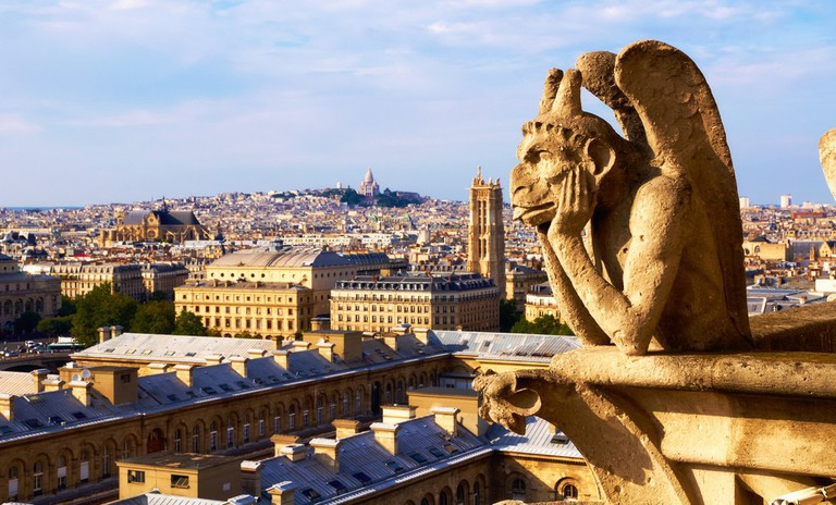 A gargoyle on one of the towers of Notre-Dame │© Moyan Brenn