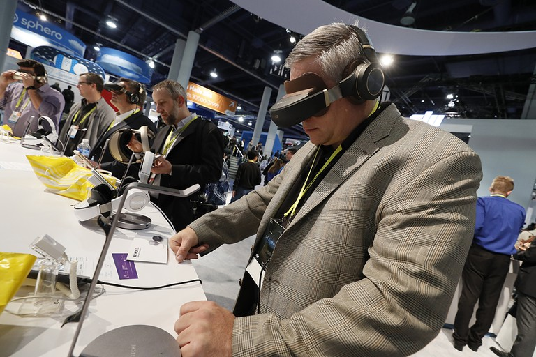 Attendees of CES try VR headsets. | Courtesy CES
