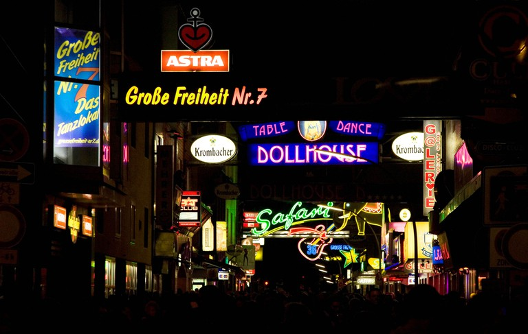 Neon lights and signs for bars and nightclubs on the Grosse Freiheit in Hamburg's St Pauli District.