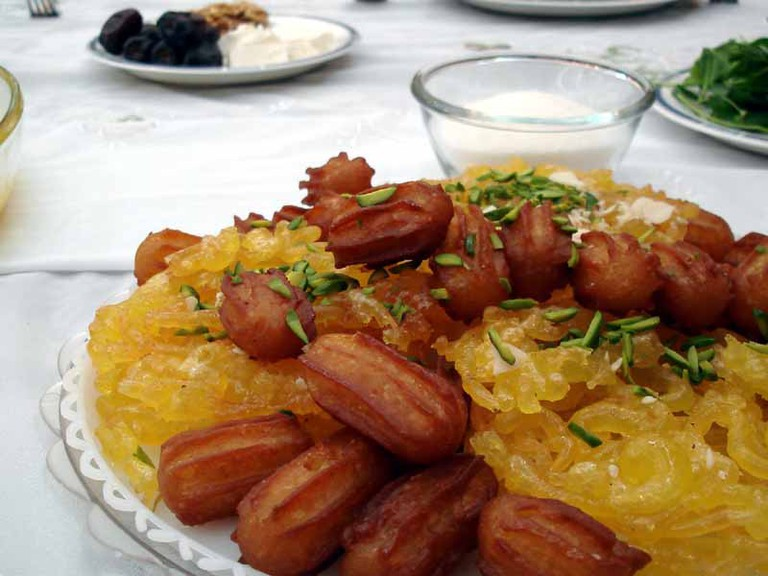 Golden zoolbia and bamieh topped with emerald pistachios | copy; Hamed Saber / Flickr