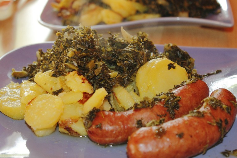 Kale served with fried potatoes and sausages