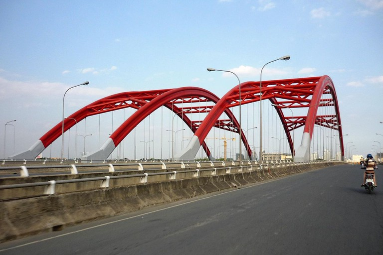 The distinctive red structures of Ông Lớn Bridge