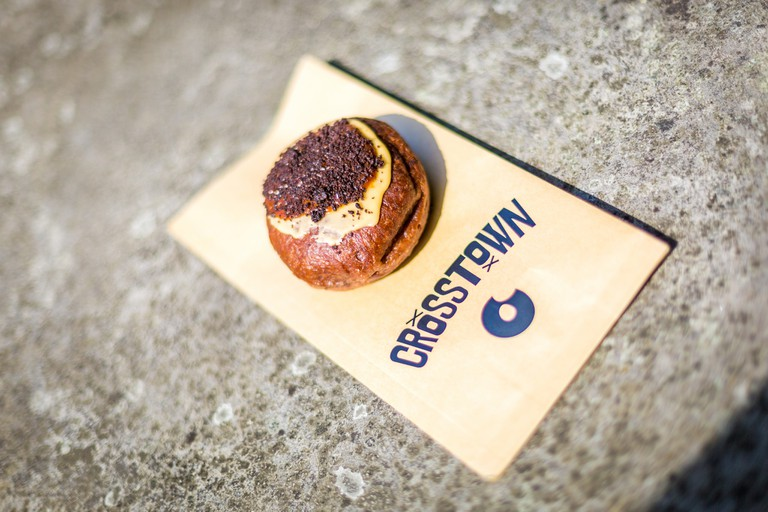 A Crosstown doughnut on a paper bag