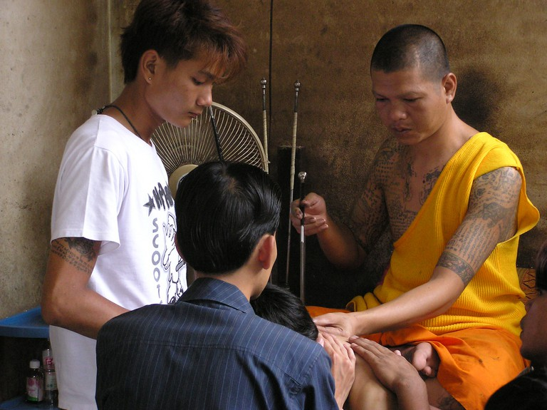 A monk tattooing in Thailand