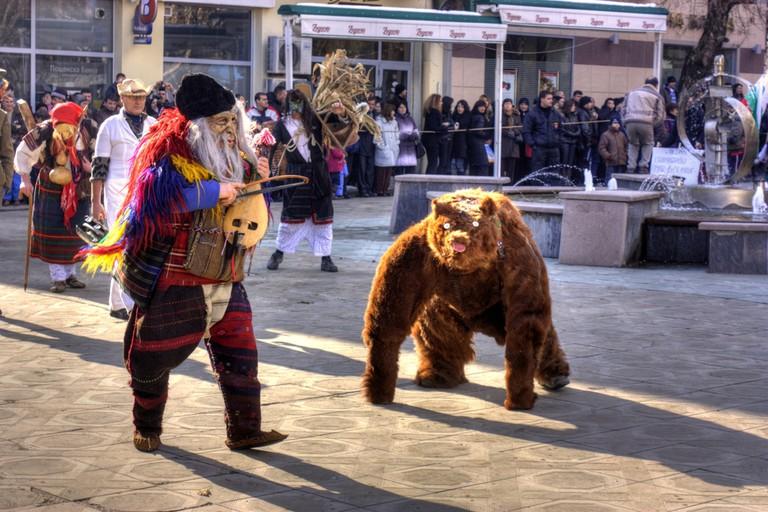 Kukeri dance with a bear