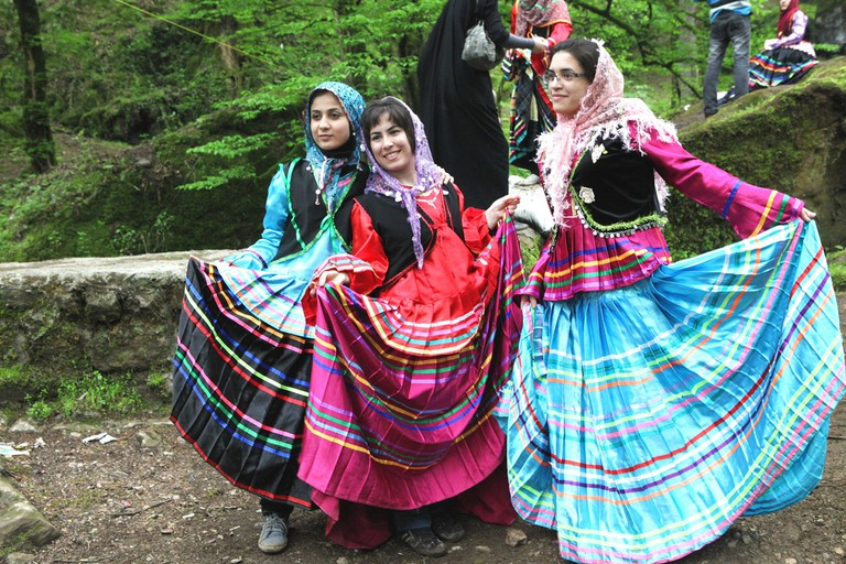 Tourists try traditional Gilaki clothes