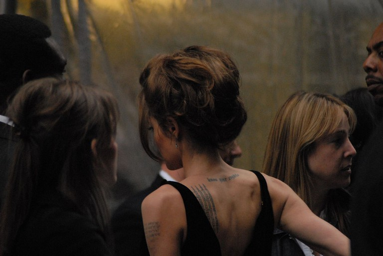 The Thai script on Angelina Jolie's left shoulder