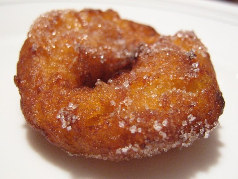 Bunuelos with sugar are a traditional Valencian snack during Las Fallas