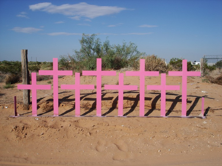 Crosses marking the mass grave of femicide victims in Chihuahua