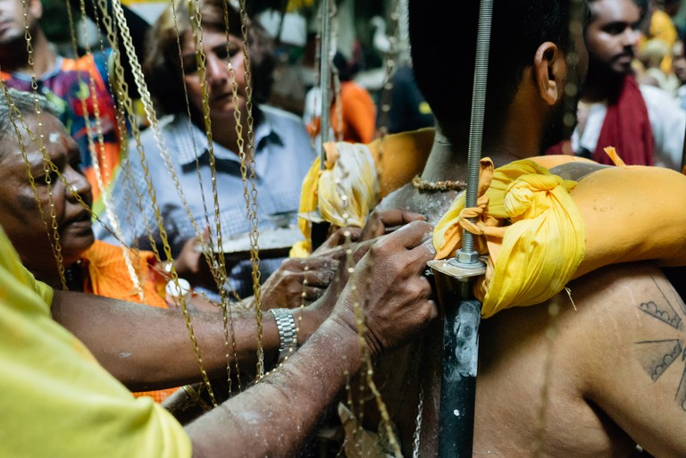 You'll see a lot of devotees having their skin hooked and pierced throughout the festival