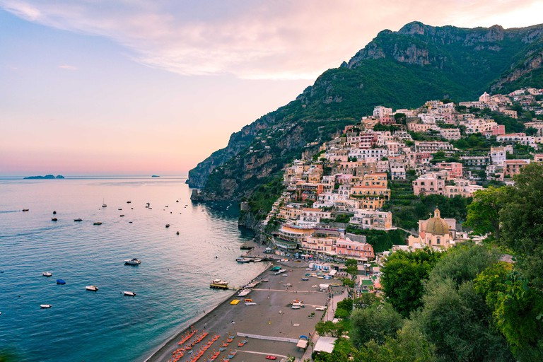 View of the town and the seaside in a summer sunset, Positano, Italy