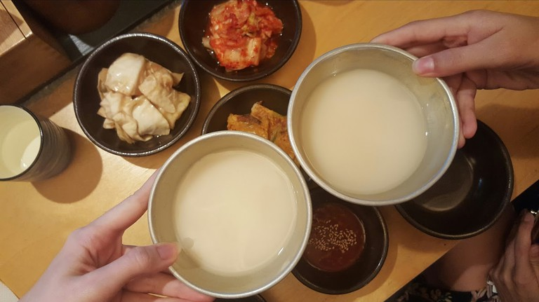 Makgeolli, Jeonju's famous milky spirit, is often served in copper kettles and bowls