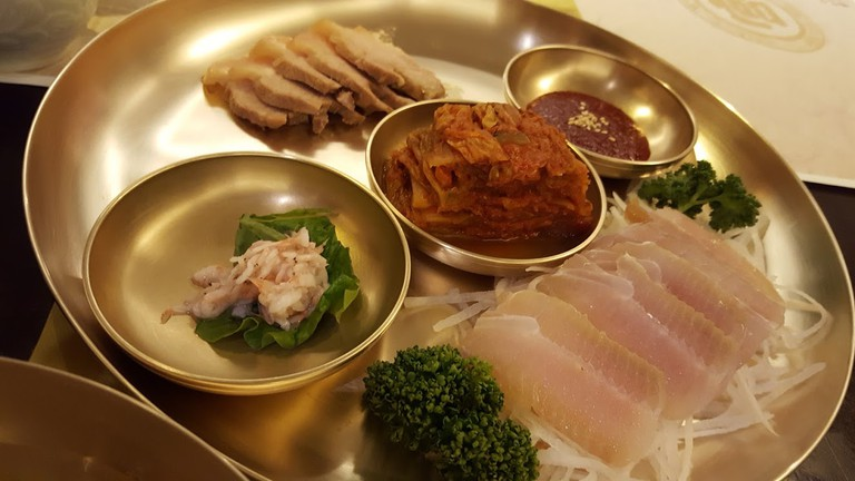 Jeonju Royal Court Cuisine served on beautiful brassware