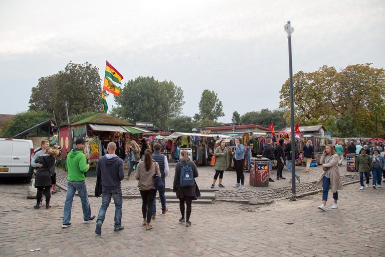 People on Pusher Street in the Freetown district Christiania