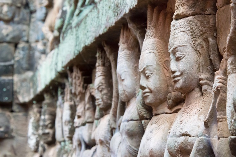 Apsara dancers can be seen carved into the walls at Angkor