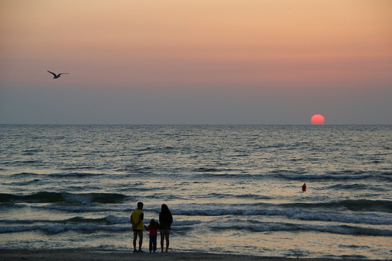 Tourists watching the sunrise in Mamaia