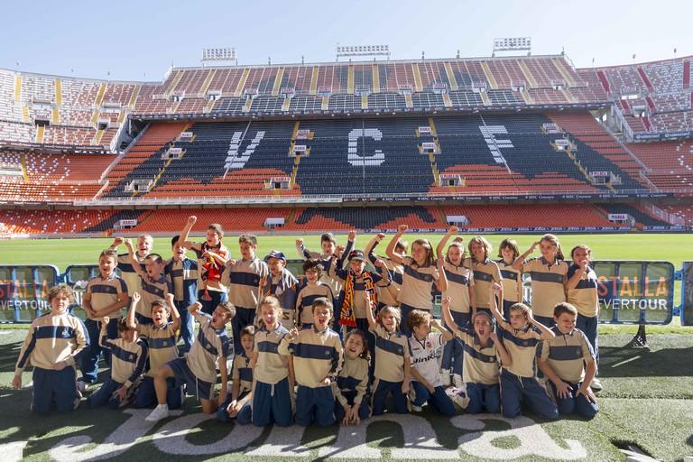 Young fans on a tour of the Mestalla Stadium, Valencia. Valencia FC fans at the Mestalla stadium. Photo courtesy of Valencia Tourism