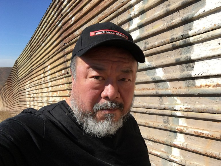 Ai Weiwei at the US/Mexico border, Tijuana, 2016 Image courtesy of Ai Weiwei Studio
