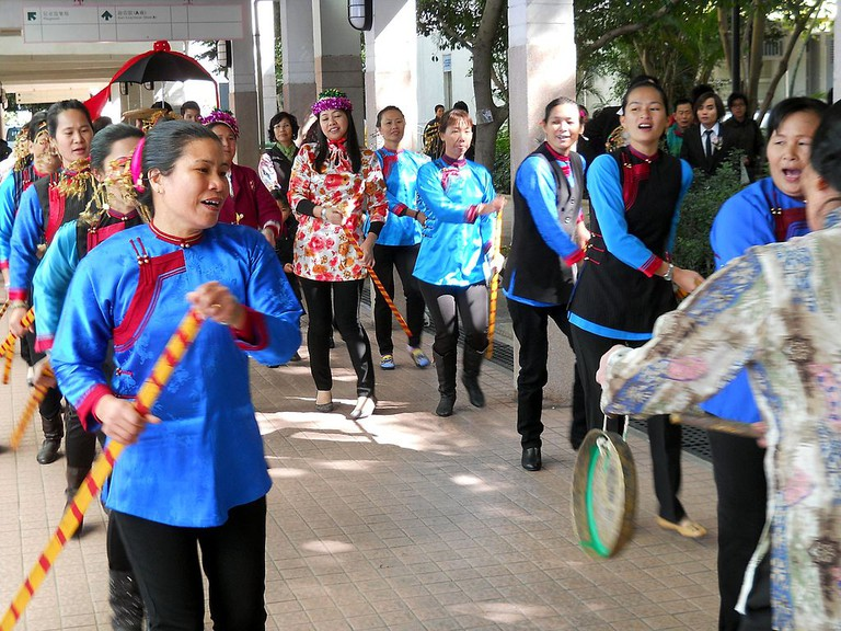 Hakka women participating in a dragon boat dance