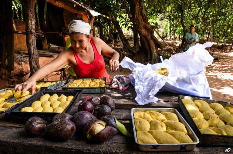Local woman preparing chipá in rural Paraguay