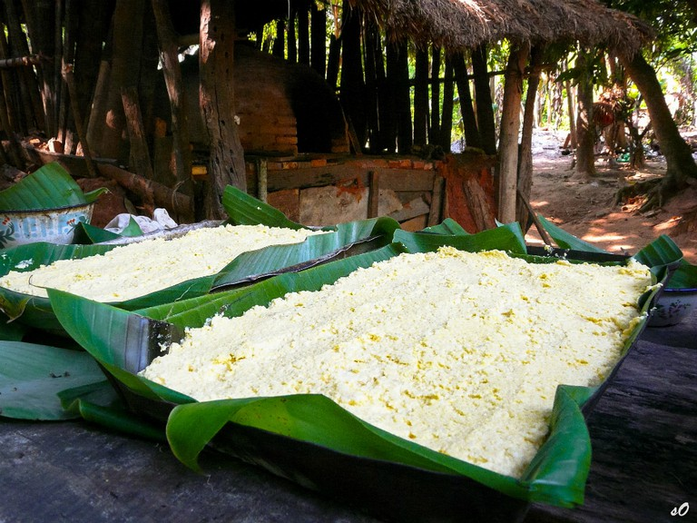 Banana leaves filled with sopa Paraguaya – an open pie made from ground corn, cheese, eggs and milk