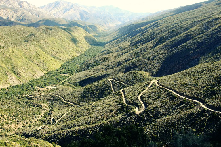 The valley is surrounded by the Swartberg Nature Reserve
