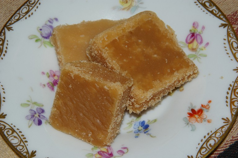 Crumbly, sugary tablet