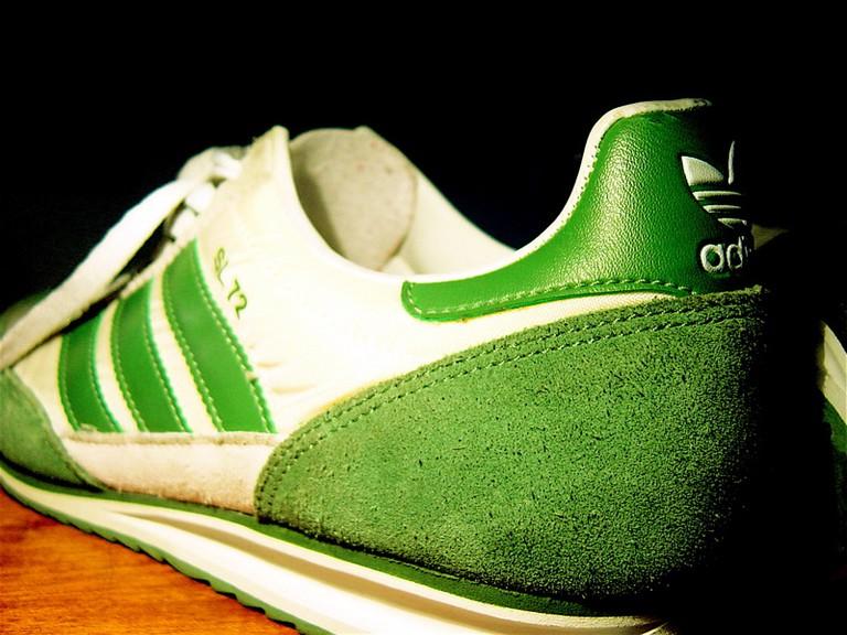 A pair of green adidas