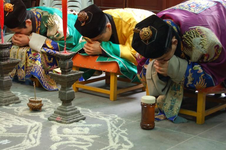 Taoists in prayer