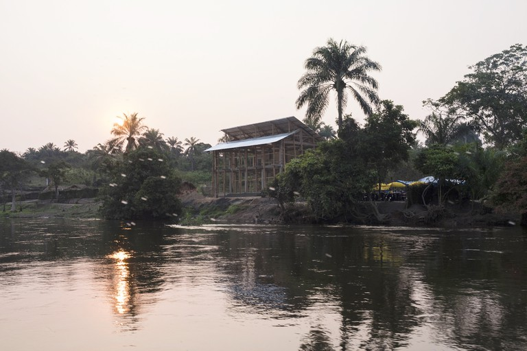 The OMA designed conference center under construction, view from Kwenge river | © L onard Pongo