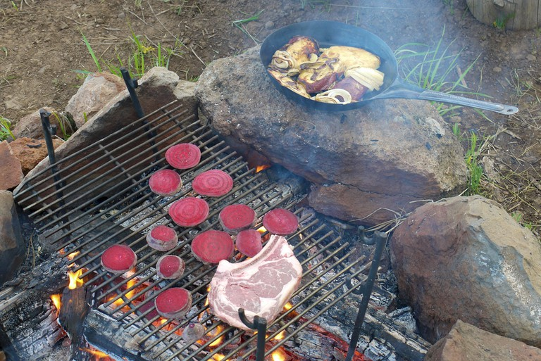 Cooking meat over an open fire
