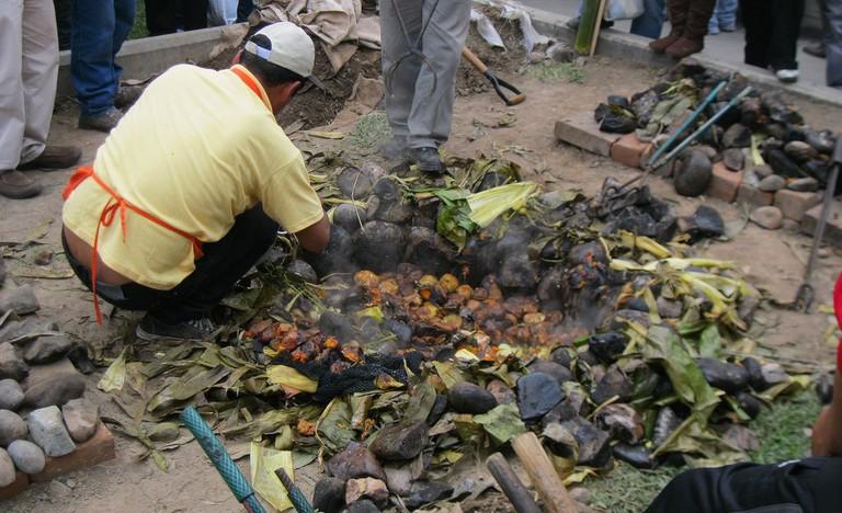 A man preparing pachamanca