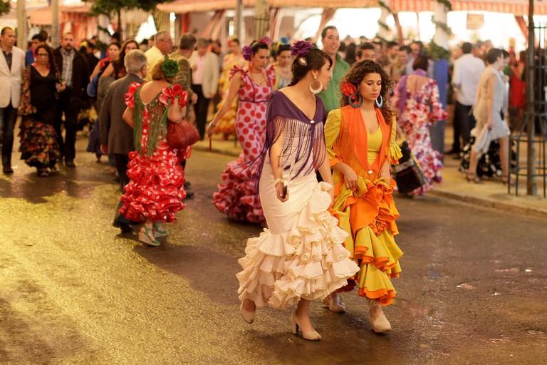 Women wear beautiful flamenco dressed during Seville´s feria; Ollie Harding, flickr